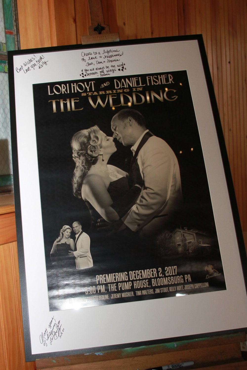 A poster displayed at the wedding that several guests signed for the couple