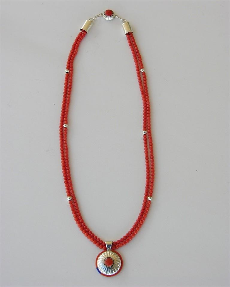 Coral necklace with silver embossed pendent