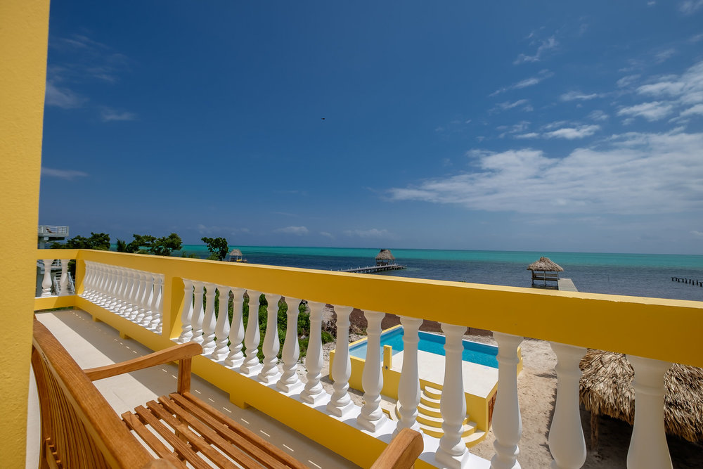 This private beachfront, completely-furnished home has 2 bedrooms, 2 1/2 bathrooms, laundry, private pool, 2 palapas and a pier.  It's comfortable for a family of 4-6 or two couples, each with their own bedroom and bath.