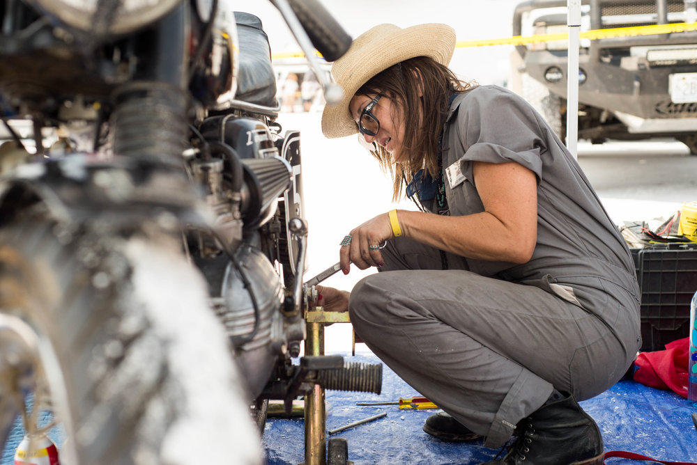 Stacie B. London, TripleNickel555, working on her bike in impound at Bonneville Speedweek.