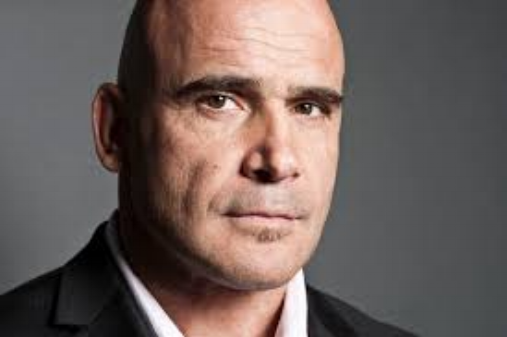 Bas Rutten is considered one of the top 5 greatest fighters in mixed-martial art's history. He has also made a name for himself outside the ring as an actor, host, and television personality.  As an actor Rutten can be seen co-starring in the Kevin James feature film Here Comes the Boom for Columbia Pictures. Rutten previously appeared in Paul Blart: Mall Cop (2009) and lent his talents to the voice cast of Zookeeper (2011). He co-hosts the weekly MMA news program Inside MMA on HDNet, and he can be seen this fall hosting the self-defense show Punk Payback for Fuel TV. Rutten has provided color commentary for several fight organizations including the former Pride Fighting Championships.  He is the former Dutch Muay-Thai Champion, former 3 time Undefeated King of Pancrase, he is the former Undefeated UFC Heavyweight Champion. He has a 5th Degree Blackbelt in Kyokushin Karate and a 2nd Degree Blackbelt in Tae Kwon Do.