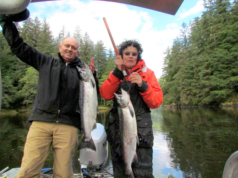 Australian visitors, Guy Fitzhardinge and Mandy Martin, with freshly caught coho salmon for the dinner table.