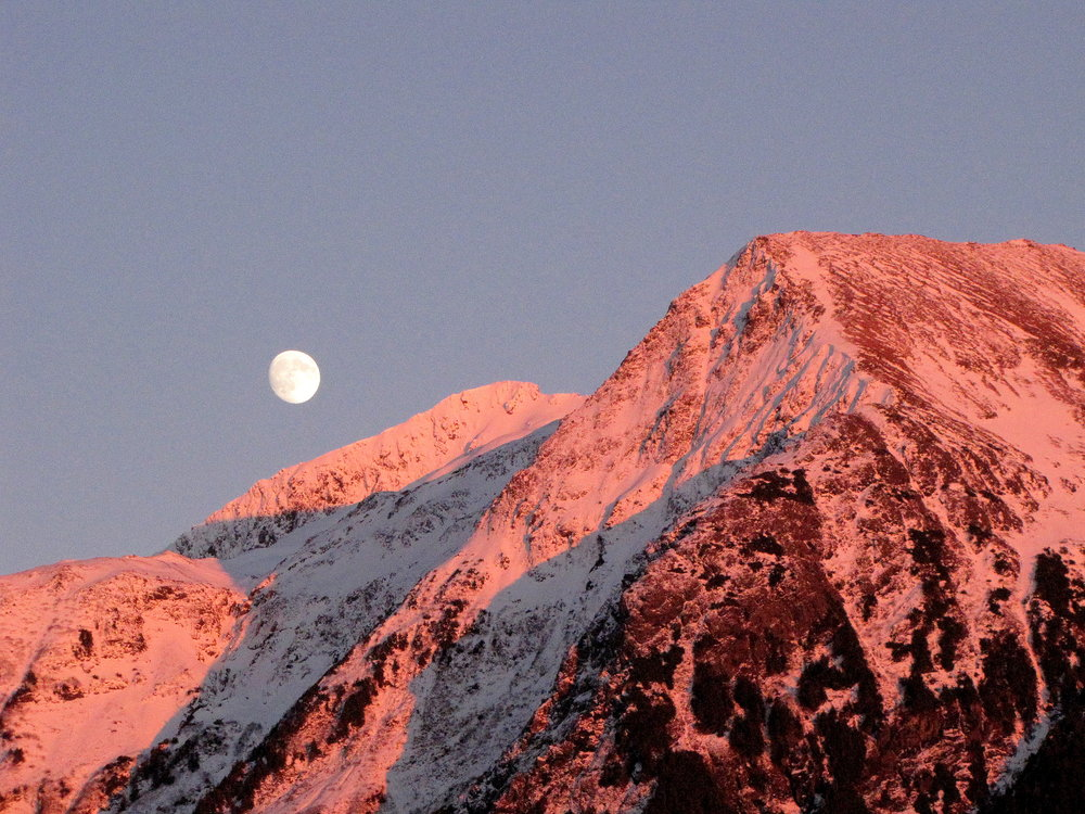 For millennia, hunters in the far north have traveled at night, when the moon casts brilliant light across the mountains and valleys.