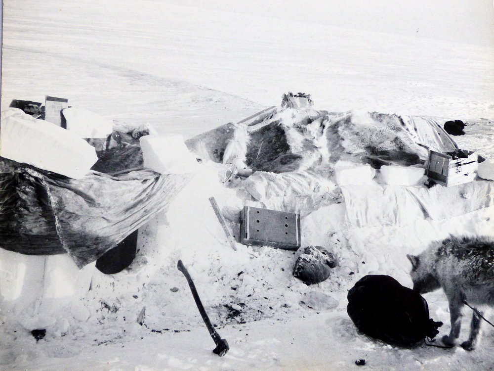 A rectangular snow block house used by Inupiaq hunters on the winter tundra of Alaska's Arctic Slope (1965 photo).