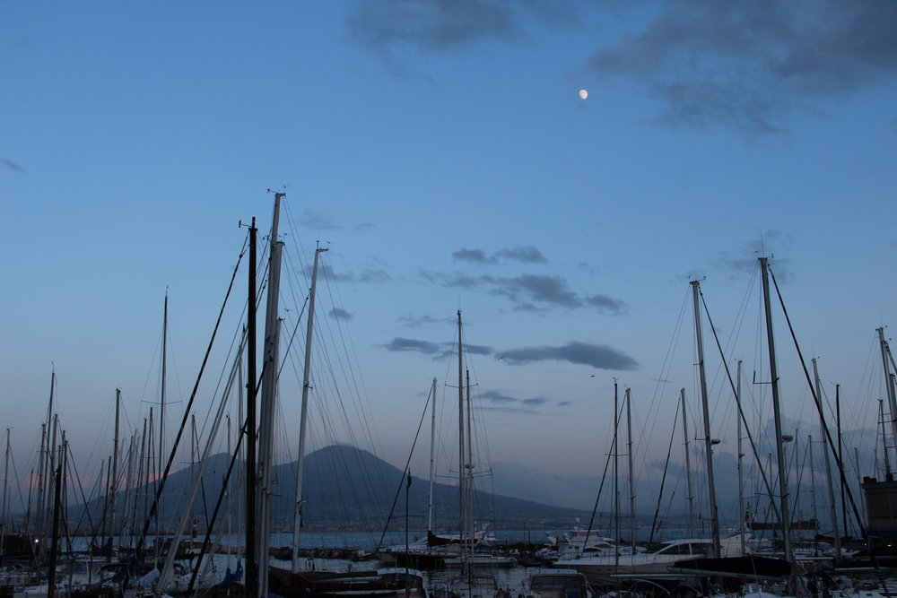 Thea beauty of the evening across the Bay of Naples towards Vesuvius