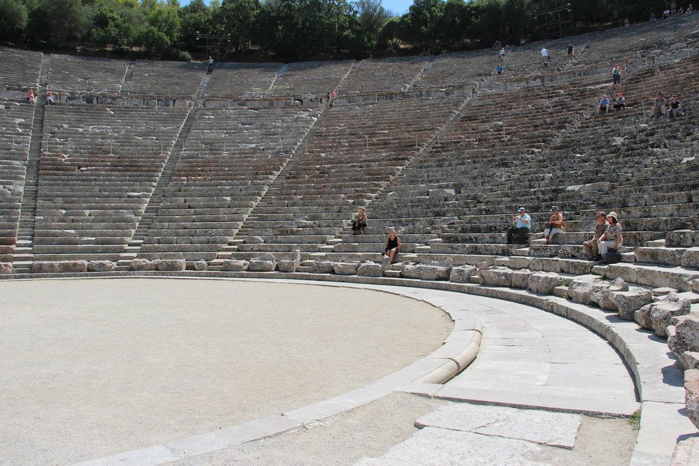 I am a very small spectator within the enormous theatre at Epidaurus