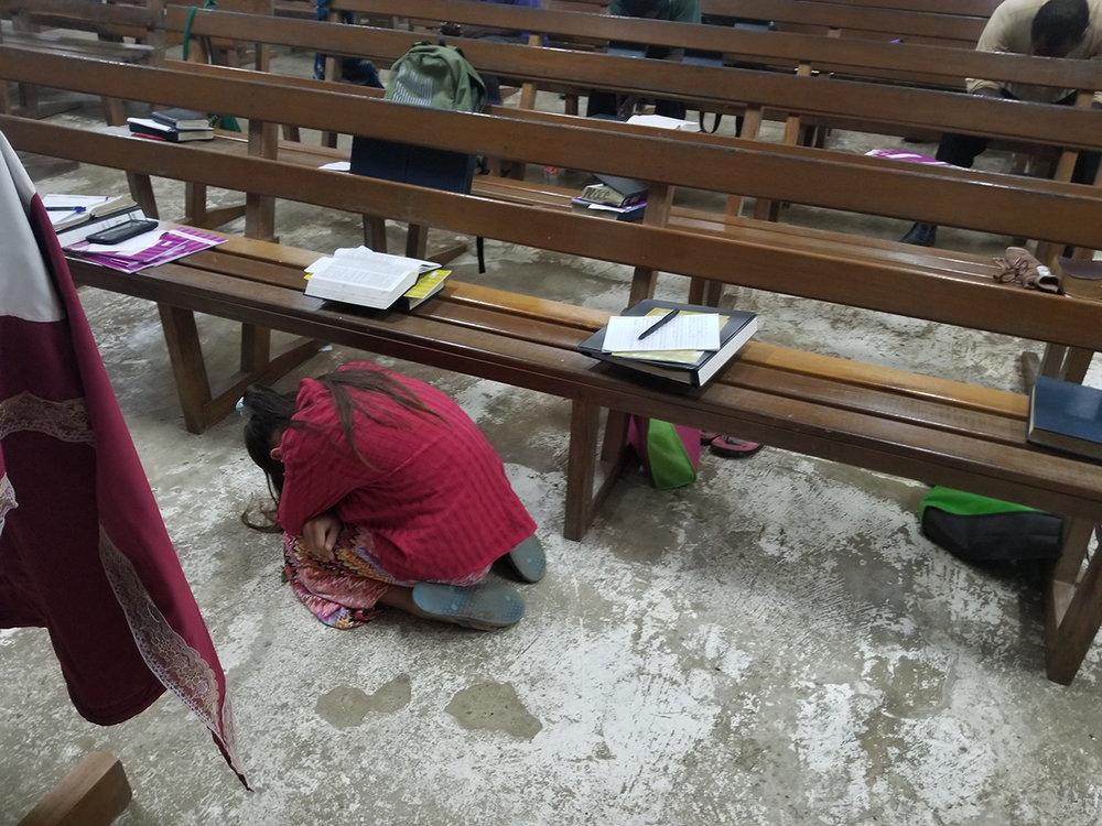 Students praying1.jpg