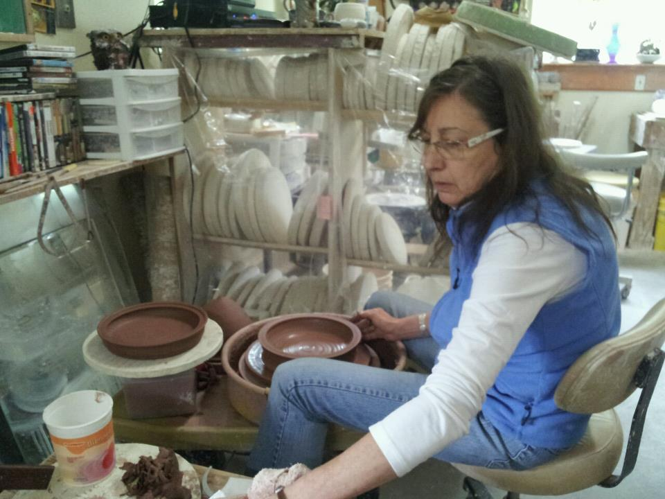 Kris Bliss  - (1950-2016)Kris, mentor and dear friend, was a wholesale potter from Anchorage, Alaska. In 1998, I walked into Kris's studio hoping to land a job as a studio assistant.  Little did I know, that visit was the beginning of a lasting friendship. I worked for Kris for four years and two summers. In that time, Kris taught me the ins and outs of maintaining a career as a production potter. I will always cherish our time together. Click here to view the interview I did with Kris in 2013.My husband and I proudly sponsor an annual National K-12 Ceramic Exhibition Award in Kris's name. The first recipient of the award, Lillie S (teacher Ramayana Baba) earned recognition for her incredible Trompe L'oeil sculpture titled Sushi Dinner.