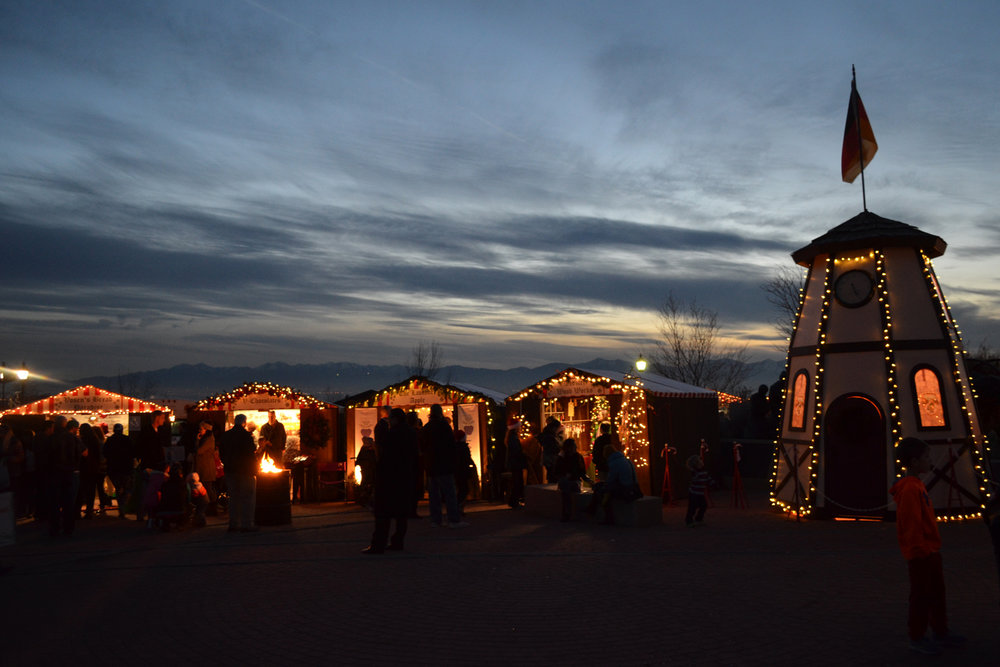 christkindlmarkt-booths-and-clock-tower-evening.jpg