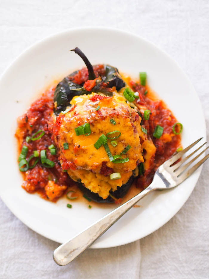 Cheesy grits stuffed poblanos with smoky tomato gravy