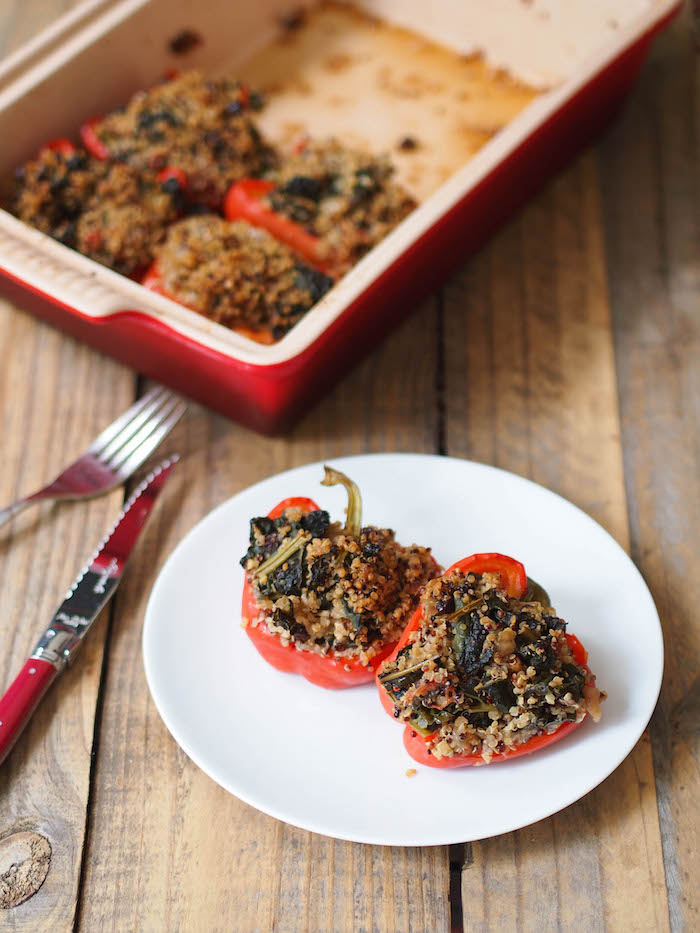 These vegan stuffed peppers are filled with a flavorful blend of quinoa, kale and Middle Eastern spices!