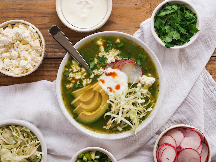 Green posole with avocado and feta
