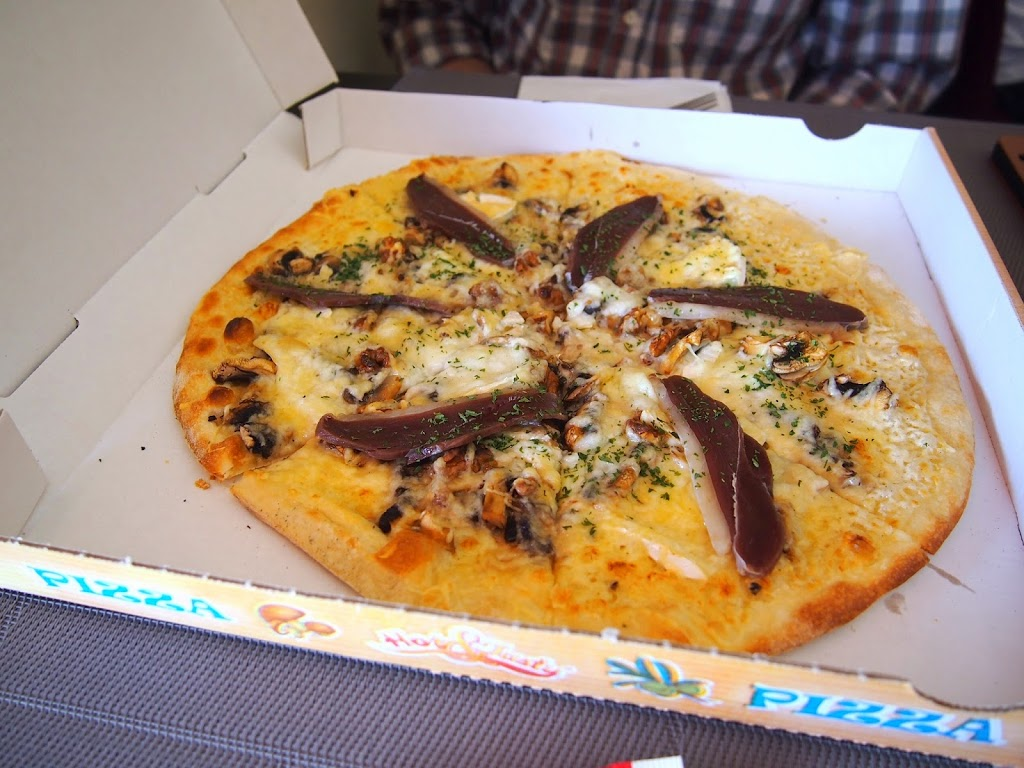 France pizza with duck proscuitto brie and mushrooms