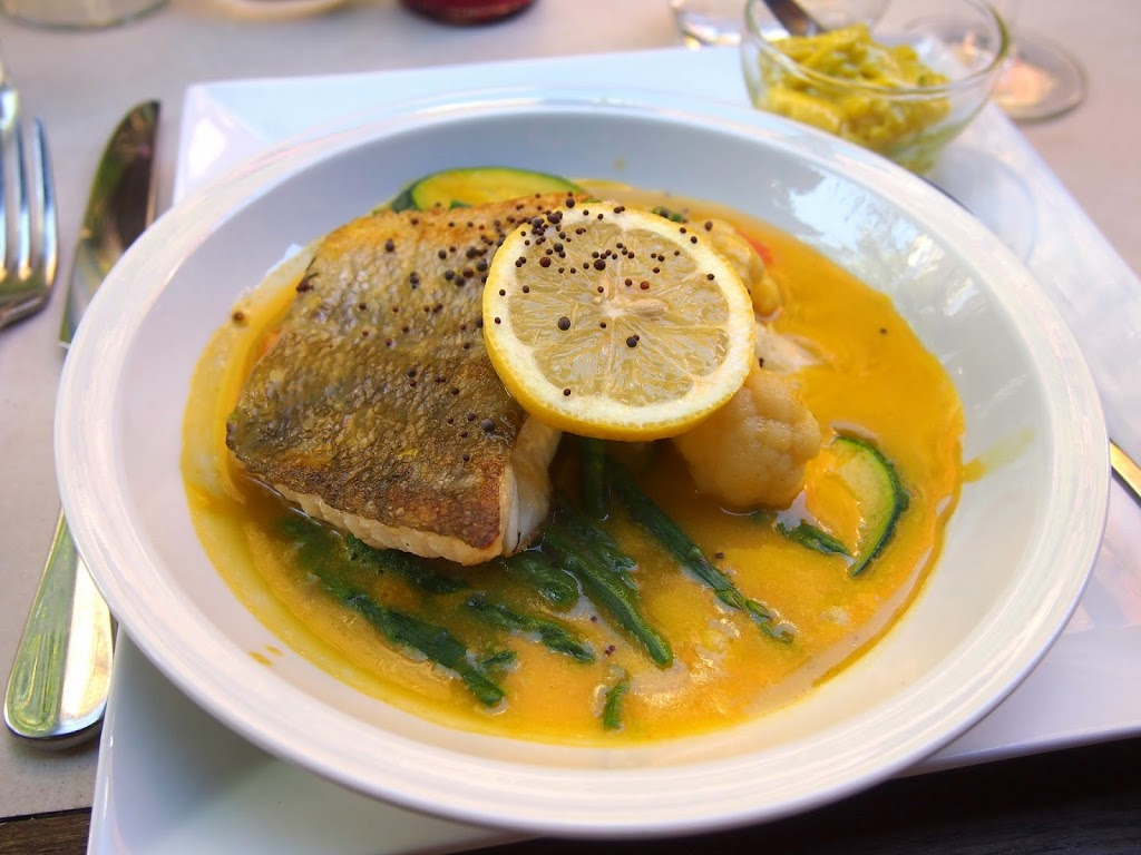Pot au feu with cod and saffron in France