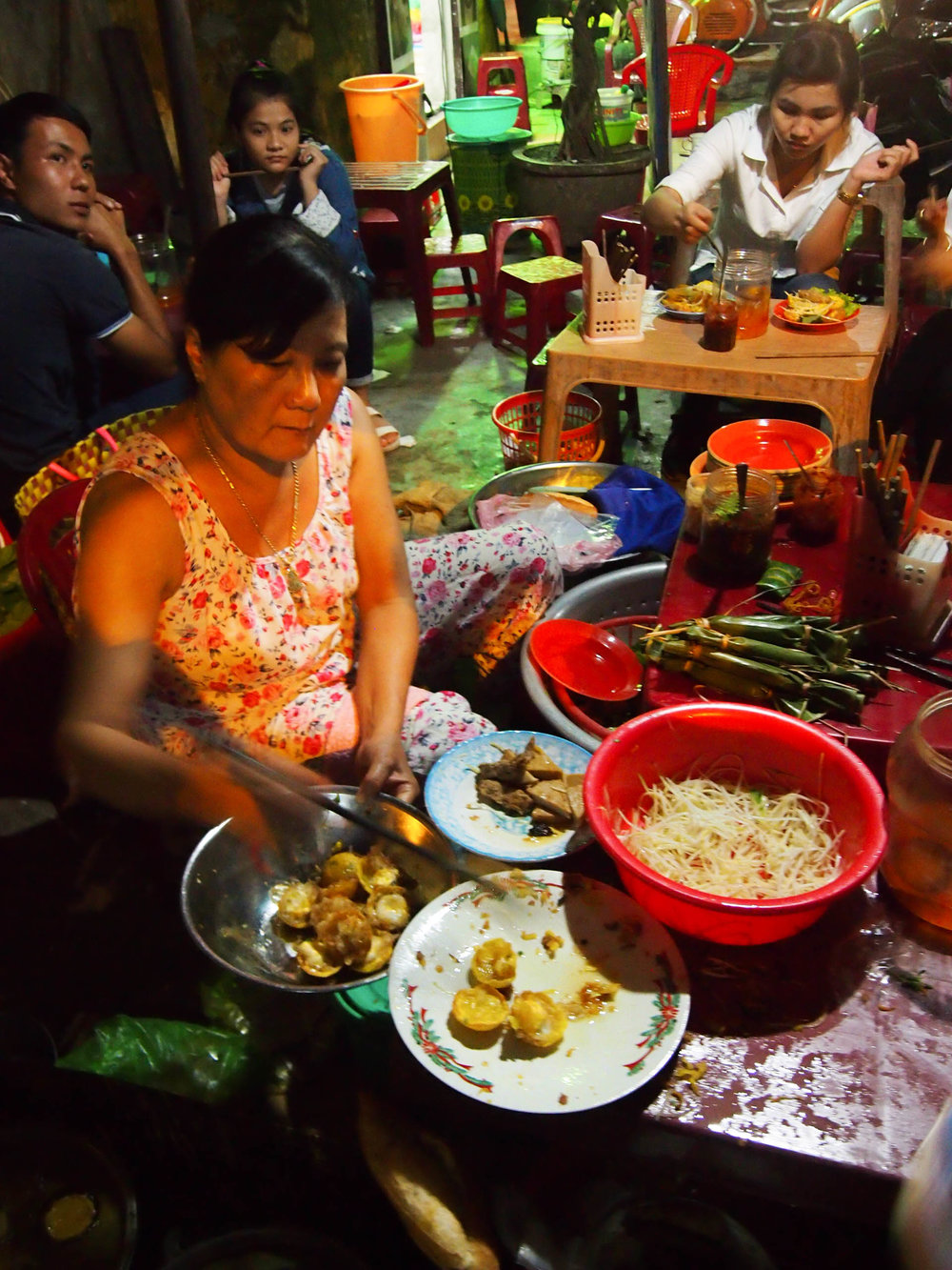 Cooking banh can in Hoi An
