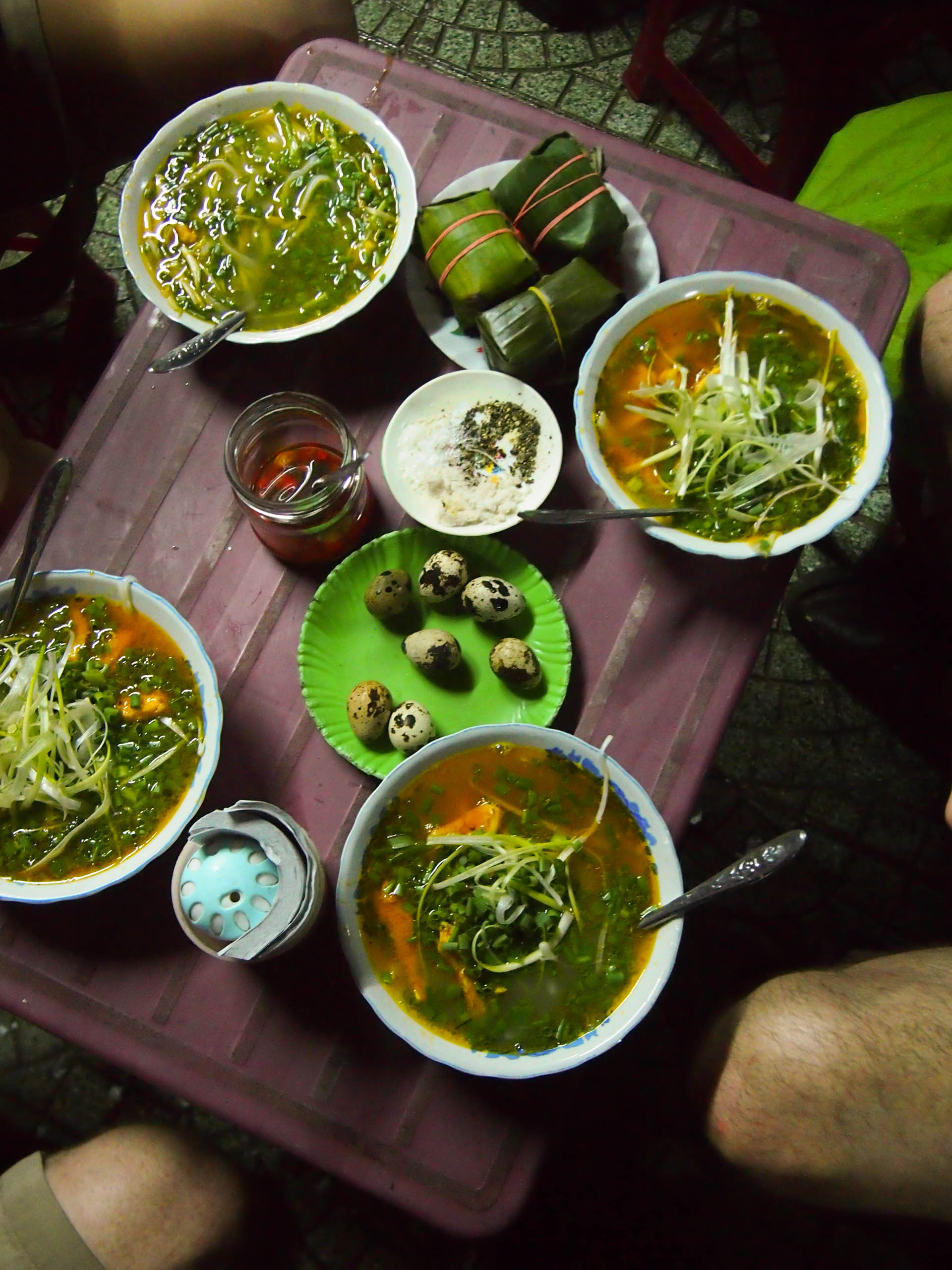 Banh canh, hard boiled quail eggs, and banh chung (stuffed sticky rice wrapped in leaves). All this and four beers cost $10. For four people.