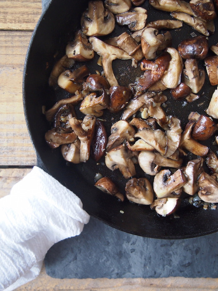 Garlicky sauteed mushrooms are the perfect topping for vegan cannelilini bean and pumpkin risotto