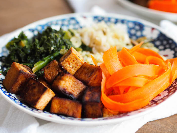 Vegan Sweet & Spicy Tofu Bowl with Garlicky Greens and Citrus Tahini Sauce