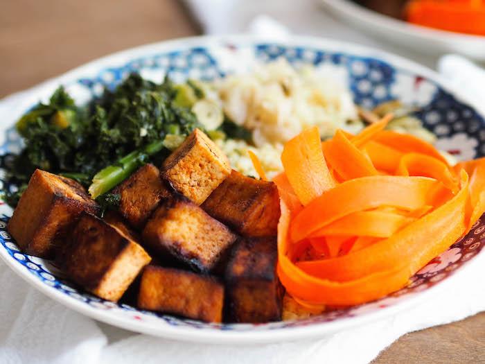 Vegan Sweet & Spicy Tofu Bowl with Garlicky Greens and Citrus Tahini Sauce