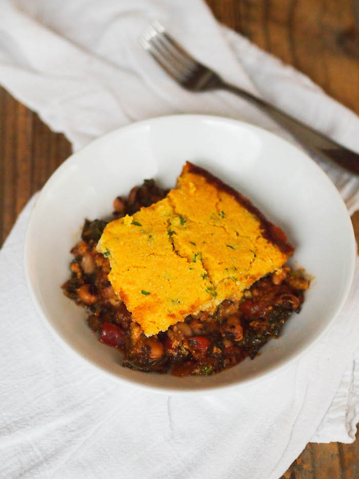 Southern black-eyed peas and greens casserole with cornbread topping for the New Year!