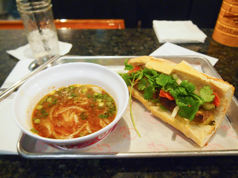 Vegetable noodle soup and lemongrass tofu banh mi at The Pig and the Lady