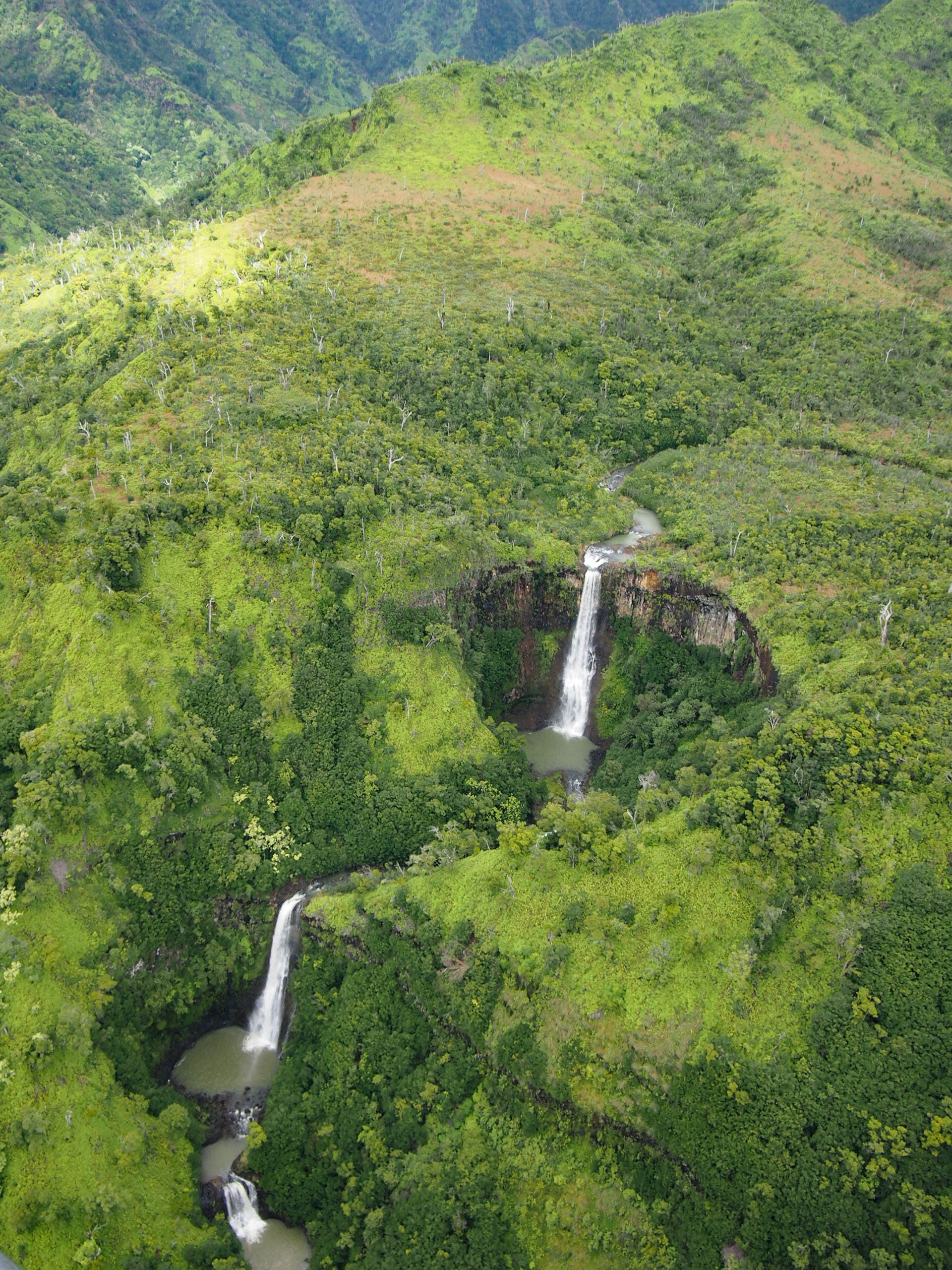 Waterfall from helicopter tour of Hawaii