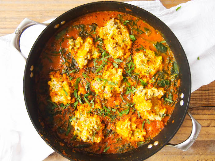 Chickpea dumplings in red curry spinach cooks much faster than you would think!
