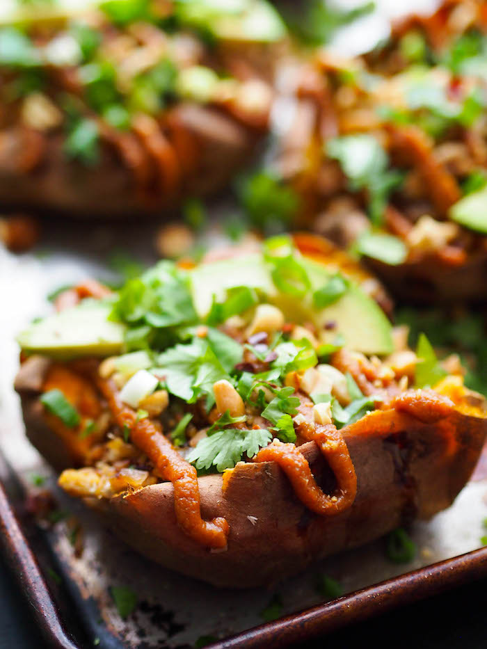 Vegan Asian stuffed sweet potatoes with tempeh and peanut sauce