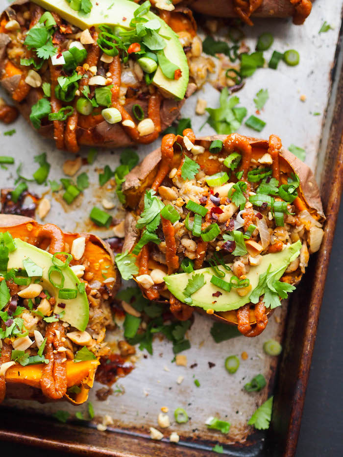 Gluten free Thai stuffed sweet potatoes with tempeh and peanut sauce