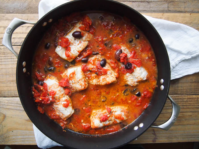 Greek Braised Cod with Kalamata Olives and Tomatoes is an easy and sustainable seafood dinner! #healthyrecipe #healthy #mediterranean #glutenfree