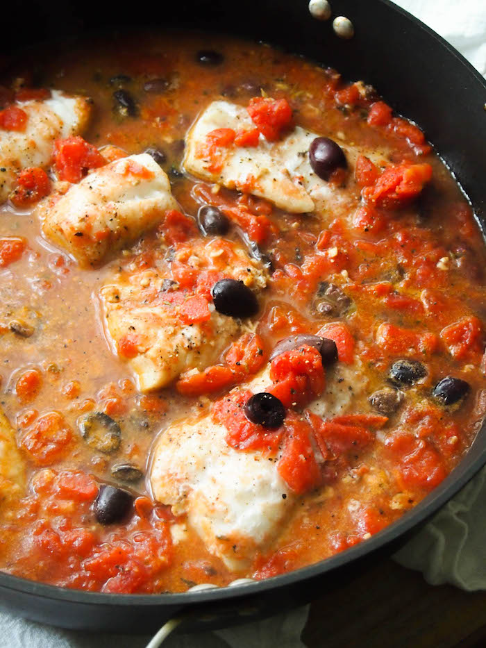 Braised fish in a Greek tomato sauce for a simple and nutritious dinner