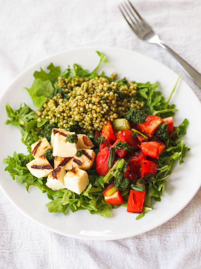Arugula salad with cubes of grilled halloumi and a grilled tomato scallion relish