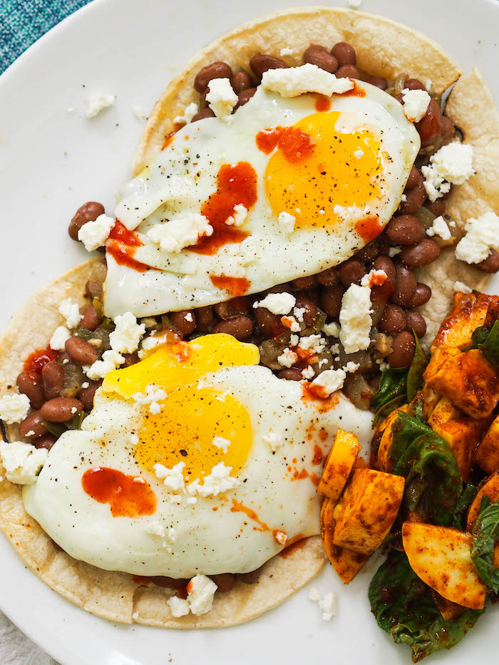 Spicy vegetarian heuvos rancheros with smoky pinto beans!