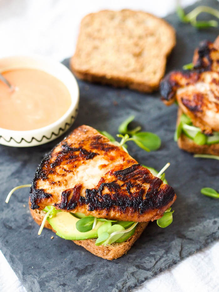 Miso grilled chicken sandwich with sriracha mayo, avocado a crunchy sprouts