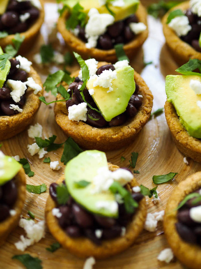 Vegetarian black bean stuffed baked sopes with salsa verde!
