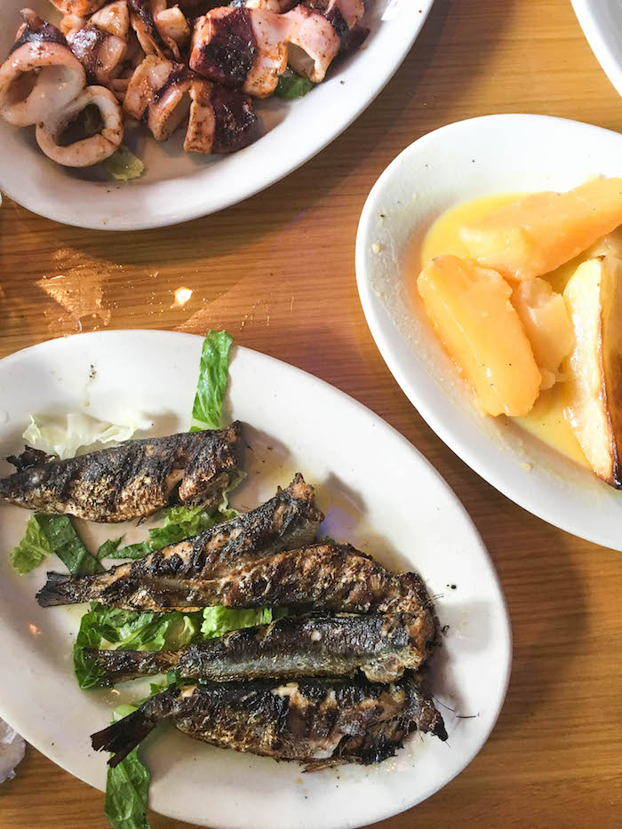Grilled sardines, lemon potatoes and grilled calamari at Taverna Kyclades in Astoria Queens