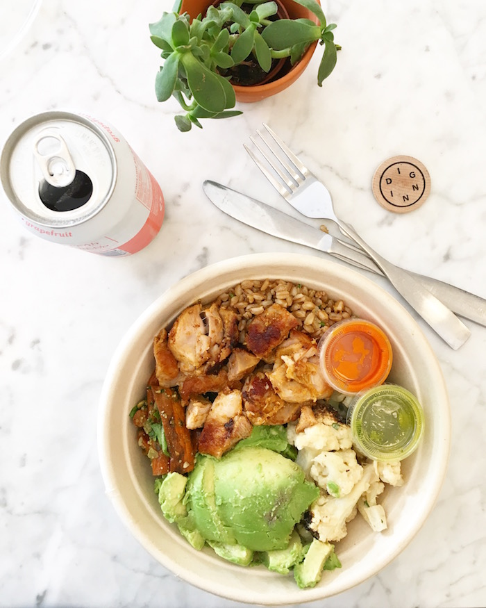 Farro bowl with charred lemon chicken, roasted carrots with pumpkin seed pesto and kale, avocado, califlower with tahini and dates, housemade sriracha and pesto.