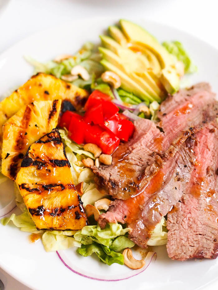 Asian flank steak salad with grilled pineapple and sesame miso dressing!