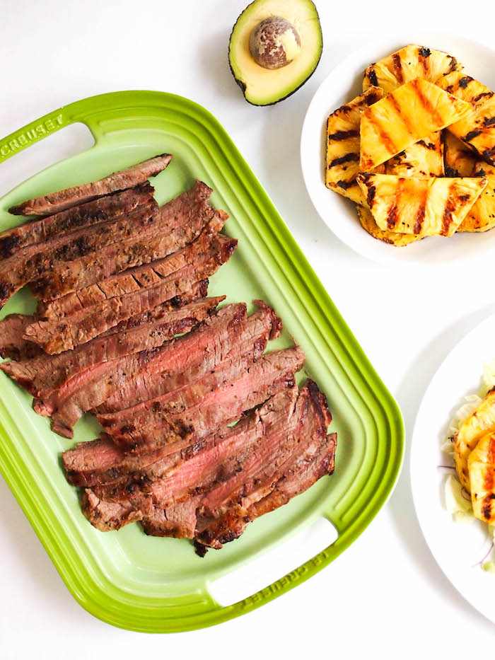 Asian grilled flank steak salad with grilled pineapple and a sesame miso dressing!