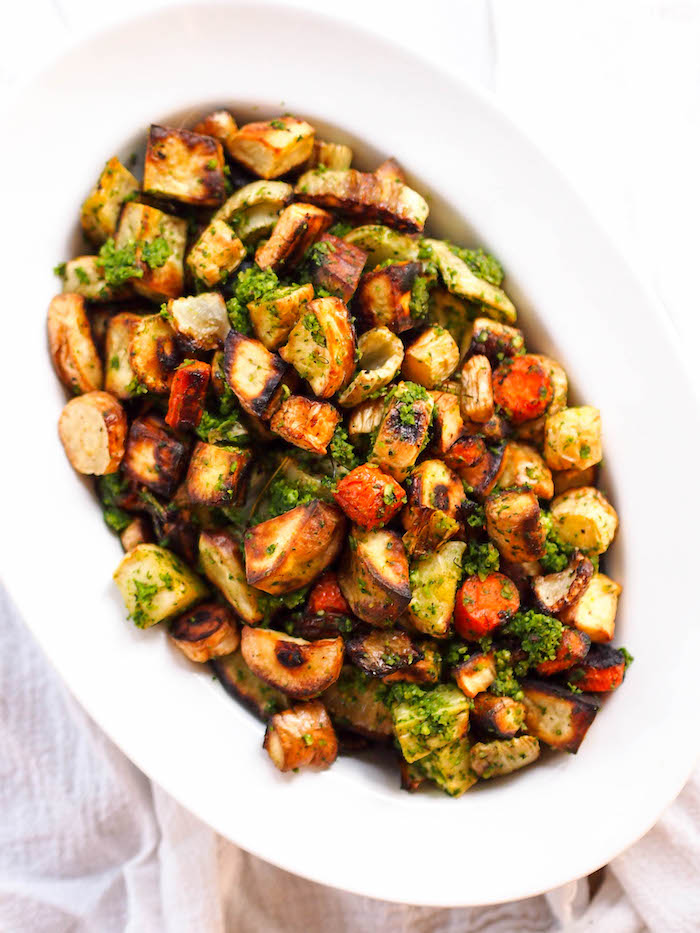 Serve sweet and crispy roasted fall vegetables with a kale and hazelnut pesto!