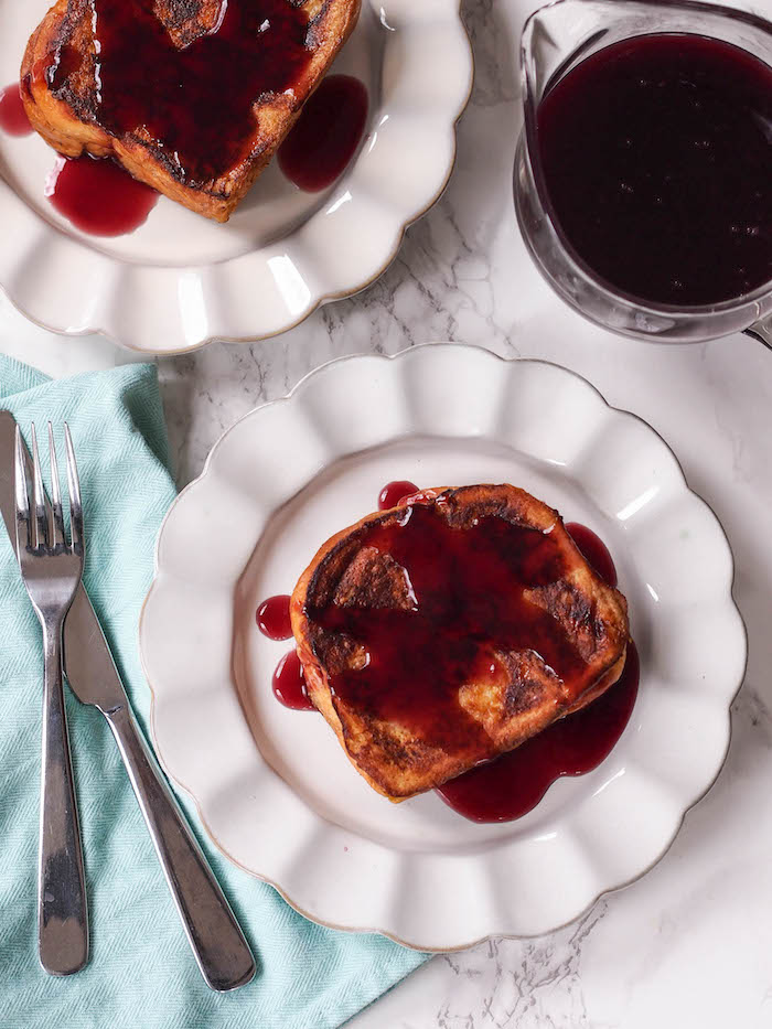Ricotta stuffed French toast made with brioche gets drizzled with a low sugar grape syrup made from 100% fruit juice!