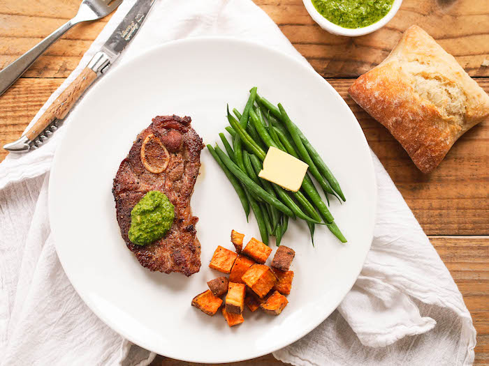 Serve this pan seared lamb chop with green harissa alongside simple steamed vegetables and roasted sweet potatoes!