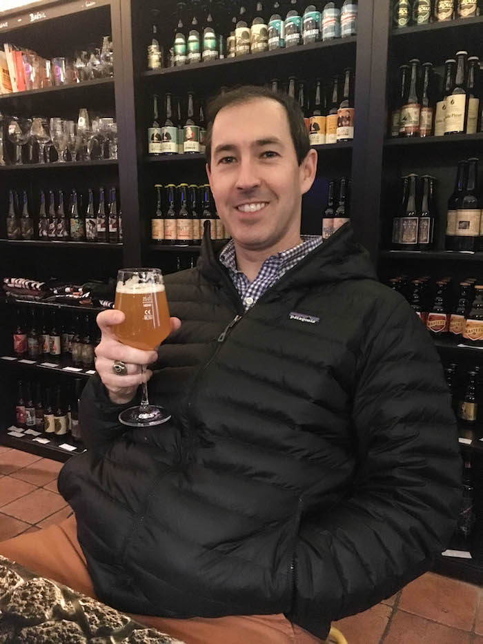 He's very happy to have a hoppy IPA after a week of wine!