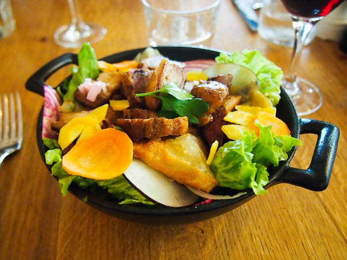 Salad heaven. Crisp fresh lettuce, peppery radish slices, sweet rounds of rainbow beets and carrots, crispy pork belly, and fried bits of the most flavorful goat cheese!