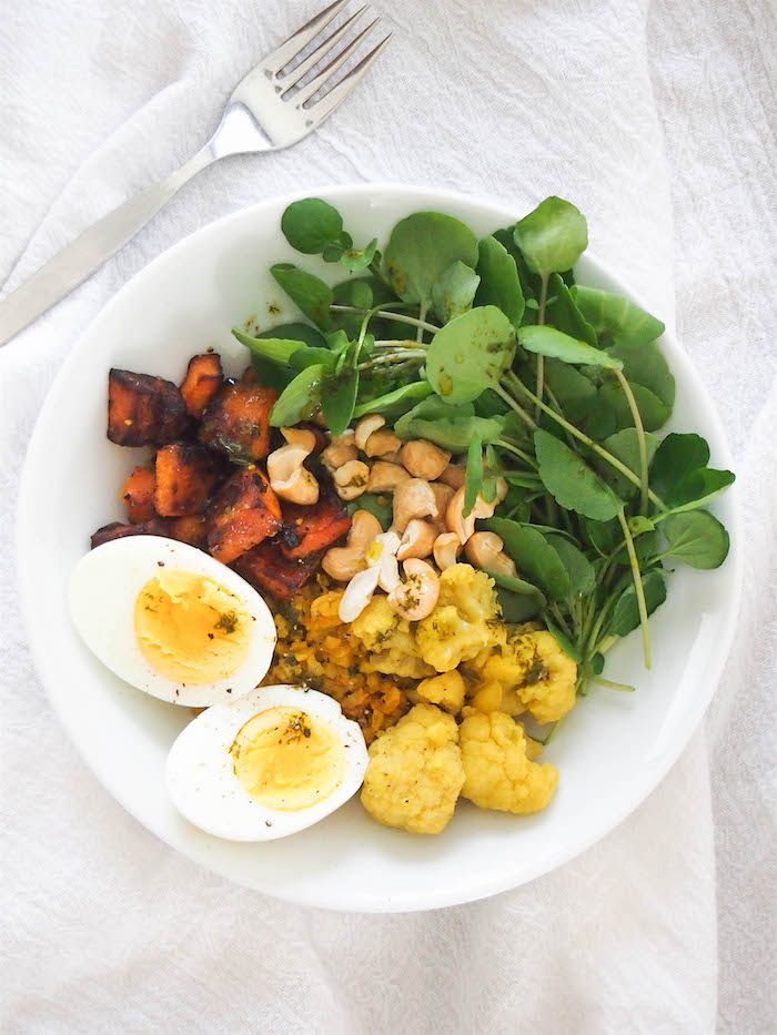 Turmeric Cauliflower Rice Bowl with Dill Oil is packed with veggies! Perfect make ahead lunch! #grainbowl #cauliflowerrice #turmeric #healthy #recipe #lunch #vegetarian