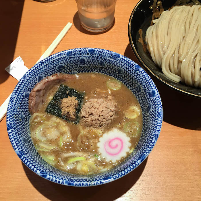 Tsukemen-style ramen. I left with a shirt covered in soup, and a very happy belly. The swirly thing is a fish cake .