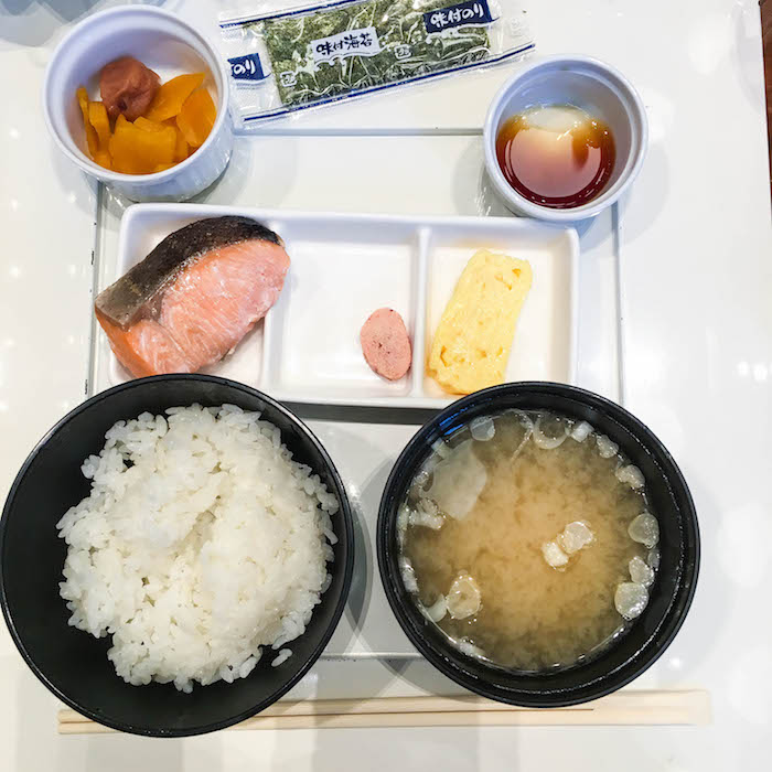 Japanese breakfast from the hotel – rice, miso soup, broiled fish, omelette, pickles, soy sauce. I'm a big fan.