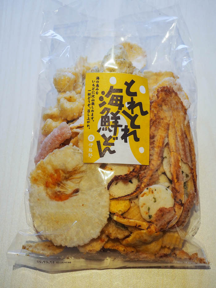 Picked up this little snack of seafood rice crackers. Check out the whole shrimp and octopus in there! Looks scary, but these were SO good.