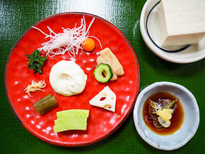 Ikemorinamasu, lots of different kinds of pickles served with tofu paste. You basically mix it all together on the plate and eat. On the side is fresh tofu served with ginger, soy and leeks.