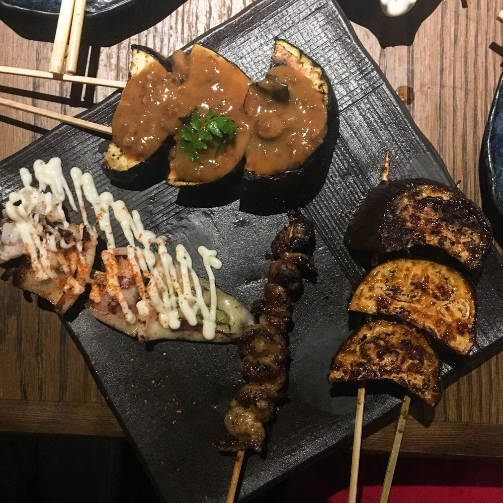 Some of the yakitori we got: eggplant with miso, soy eggplant, chicken skin and squid with kewpie mayo and chili
